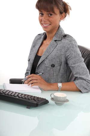 Secretary writing in her notebook Stock Photo - 13560356