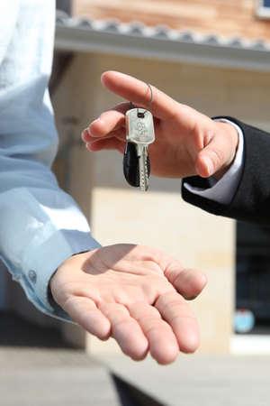 Agent handing over house keys Stock Photo - 13560754