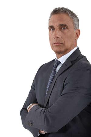 stringent: Portrait of a stoic businessman