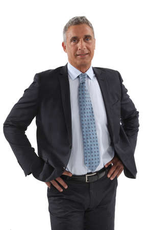 hands on hips: Businessman stood with hands on hips Stock Photo