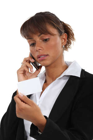 Woman with telephone and business card Stock Photo - 13560882