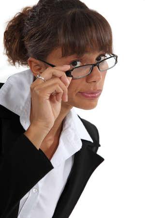 sceptic: businesswoman wearing glasses Stock Photo