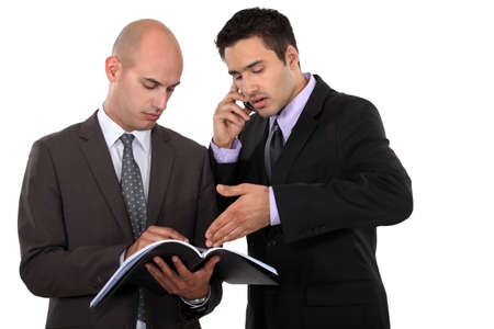 co workers: Businessmen having heated debate Stock Photo
