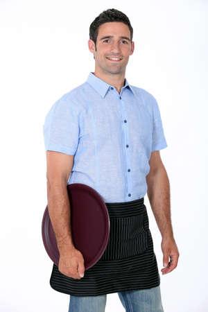mesero: Retrato de un camarero con la bandeja Foto de archivo