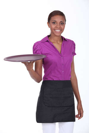 Waitress in a cafe holding an empty tray Stock Photo - 13561102