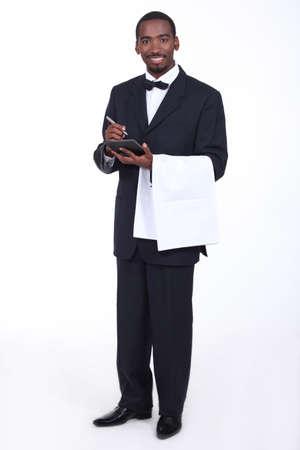 Waiter taking an order photo