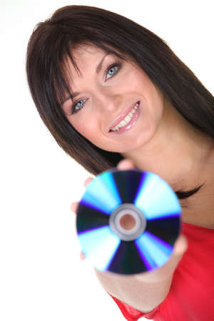 long neck: Woman holding up a CD