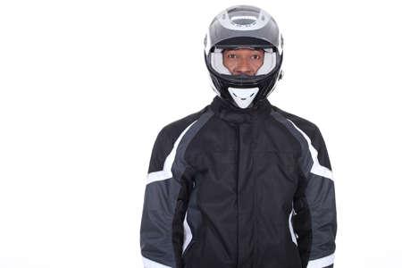 motorcycle helmet: Motorcyclist wearing black jacket and helmet Stock Photo