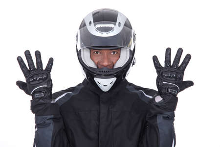 sports wear: Motorcyclist wearing black jacket, gloves and helmet