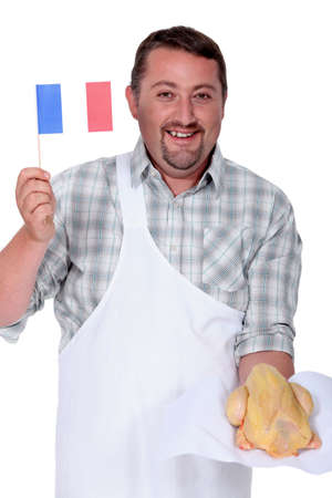 capon: Frenchman waving the flag for French poultry Stock Photo