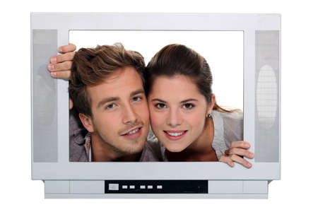 couple posing in a television frame photo