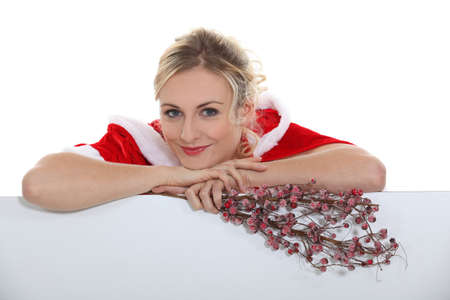 Woman dressed in festive outfit holding flowers photo