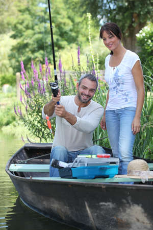 Couple in a fishing boat photo