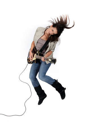 Girl rocking the guitar photo