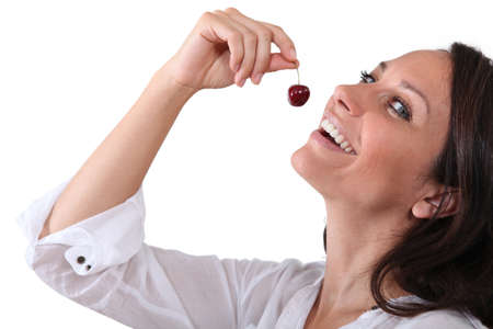 Woman eating a cherry photo