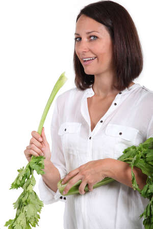 woman holding fresh parsley leaves Stock Photo - 13560591