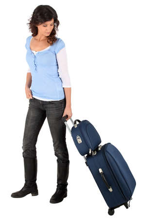 stuck up: Woman with suitcases