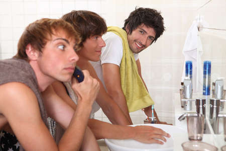 Three young men in bathroom photo