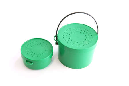 Two green tins with perforated lids Stock Photo - 13560190
