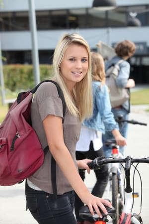 fair hair: Teenager pushing bike
