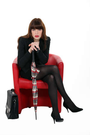 phlegmatic: elegant business woman sitting in armchair