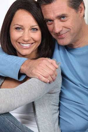 mid adult male: Portrait of a loving middle-aged couple