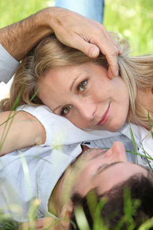 45 49 years: Closeup of lovers in the grass