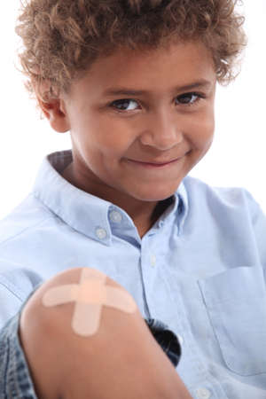 heal care: Cute boy with a plaster on his knee