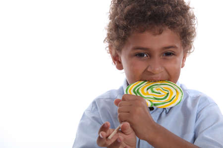 lolly pop: Boy eating a lolly pop