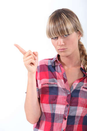 irked: Scolding young woman wagging her finger