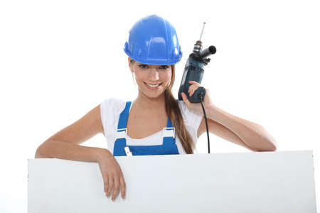 Woman with drill photo
