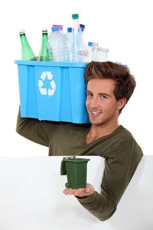 Man recycling bottles photo