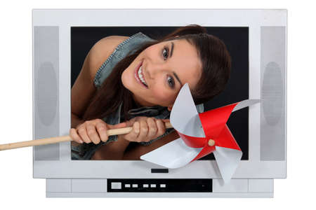 speakers desk: Woman coming out from TV with a grinder