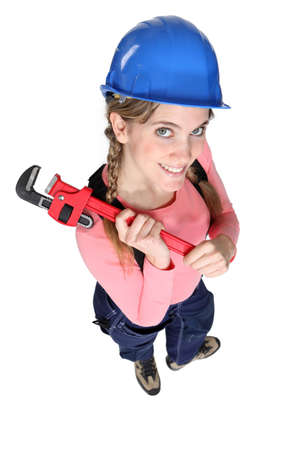 engineer's: Happy female worker holding wrench Stock Photo