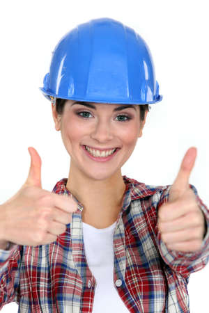 ebullient: Smiling tradeswoman giving two thumb