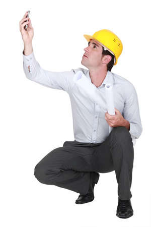 above 25: Architect trying to get phone signal Stock Photo