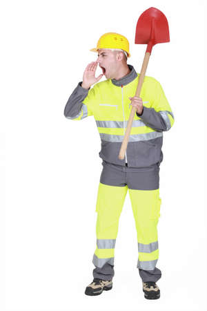 overseer: Manual worker with shovel shouting Stock Photo