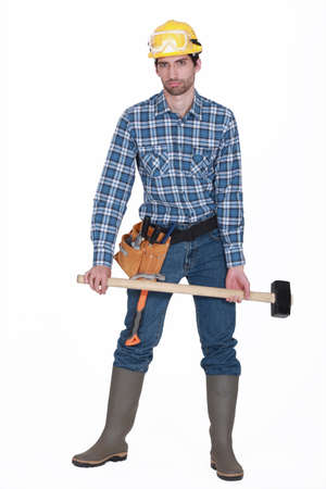 A handyman with a sledgehammer  photo