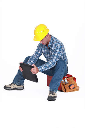 Construction worker sat on his tool box photo