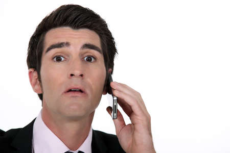 Businessman surprised by call Stock Photo - 13561134
