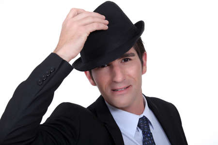 Businessman doffing his hat Stock Photo - 13561140