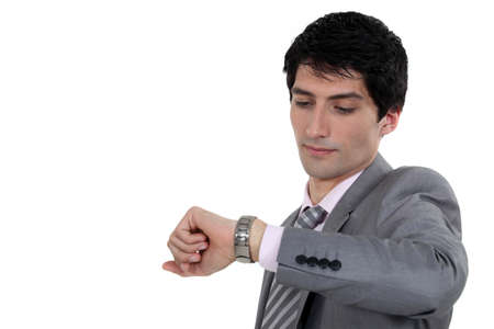 Businessman looking at wrist watch Stock Photo - 13561237