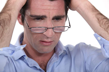 man with glasses lowered on his nose looking annoyed Stock Photo - 13560579