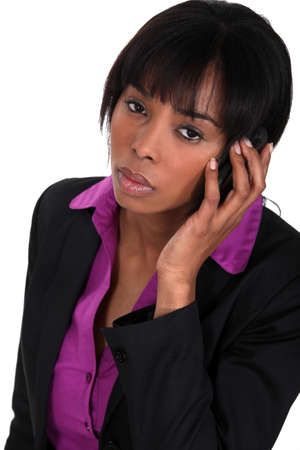 cheerless: black businesswoman making a call isolated on white