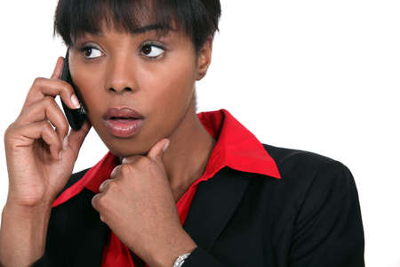 beautiful black woman making a call isolated on white photo