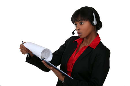 black businesswoman with headset holding clipboard Stock Photo - 13561348