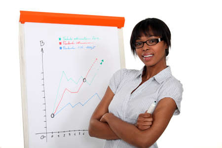 one to one meeting: Businesswoman in front of a flipchart Stock Photo