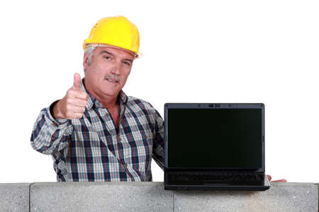 headway: Approving tradesman embracing technology Stock Photo