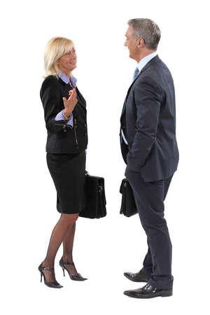 socialize: Businesspeople making small talk Stock Photo