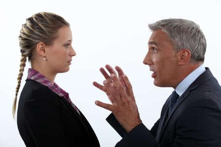 disrespect: Boss yelling on young employee Stock Photo